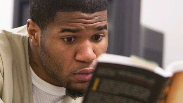 Advocates say Canadian inmates are losing some of their access to prison libraries.<br /> In this  January 2010 photo, American prisoner Michael Bennett reacts after reading a portion of a book that was shown to him by a classmate at the Cheshire Correctional Institution in Connecticut.&#8221; width=&#8221;100%&#8221; height=&#8221;349&#8243; /> <p class=