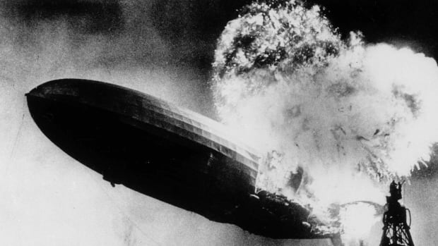 This May 6, 1937 file photo, taken at almost the split second that the Hindenburg exploded, shows the 804-foot German zeppelin just before the second and third explosions send the ship crashing to the earth over the Lakehurst Naval Air Station in Lakehurst, N.J.
