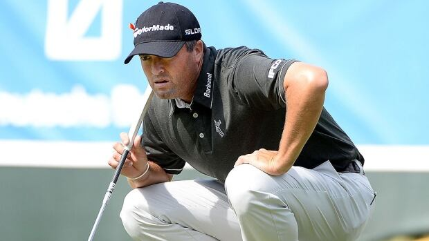 Ryan Palmer prepares to putt on the 18th green during the first round of the Deutsche Bank Championship in Norton, Mass., on Friday. Palmer needed only 21 putts on the way to a 8-under 63 and two-stroke lead over Keegan Bradley.