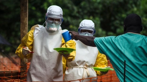 In this photo from July 20, medical staff wearing protective gear are seen in Kailahun, Sierra Leone, where recent Ebola diagnoses prompted a decision to put three Canadian workers into isolation.