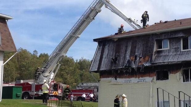 Firefighters battle the damage in east Saint John.