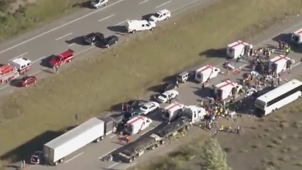 A Super Vacation tour bus carrying 56 people hit a median on Thursday afternoon about 30 kilometres south of Merritt, B.C., then skidded across several lanes and rolled into a ditch, ejecting numerous passengers.