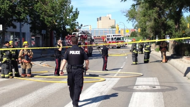 Winnipeg police cordoned off Main Street between Higgins Avenue and Logan Avenue on Saturday afternoon as crews dealt with an electrical fire underground.
