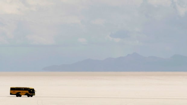 A tourist bus drives on the surface of the world's largest salt flats, the Salar de Uyuni, near the village of Colchani.