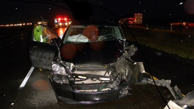 One of the vehicles involved in a collision Saturday night on the QE2 shows heavy damage.