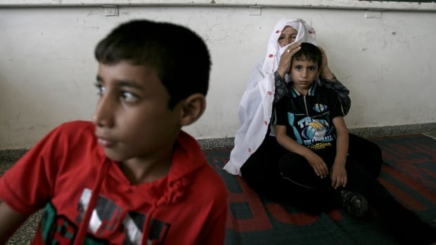 Israel has called on Arab countries to work together to rebuild the Gaza Strip while disarming Hamas militants.  Meanwhile, many people in Gaza like Harba Mahmoum and her grandchildren continue to take shelter at a UN school in the Rafah refugee camp in the southern Gaza Strip. The children lost their mother and four siblings on Aug. 1, during Israeli air and artillery fire on Rafah.