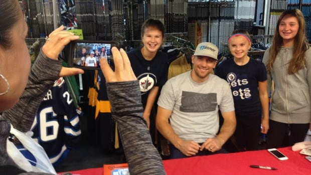 Winnipeg Jets right winger Blake Wheeler poses for photographs with fans at Royal Sports on Pembina Highway on Sunday afternoon.