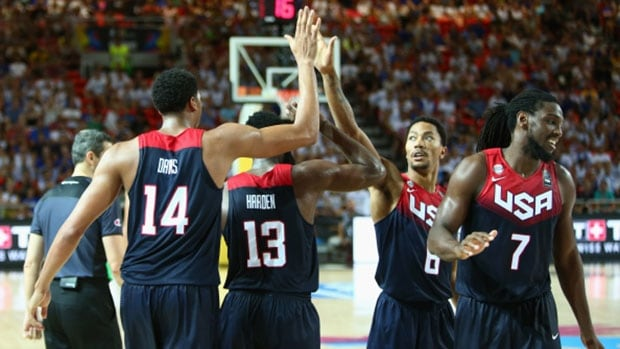 Members of the USA basketball team celebrate during their victory over Turkey Sunday at the Basketball World Cup in Bilbao, Spain.