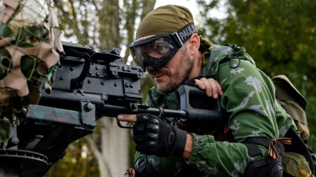 A Pro-Russian rebel prepares arms for the the assault on the positions of Ukrainian army in Donetsk airport in eastern Ukraine on Sunday.