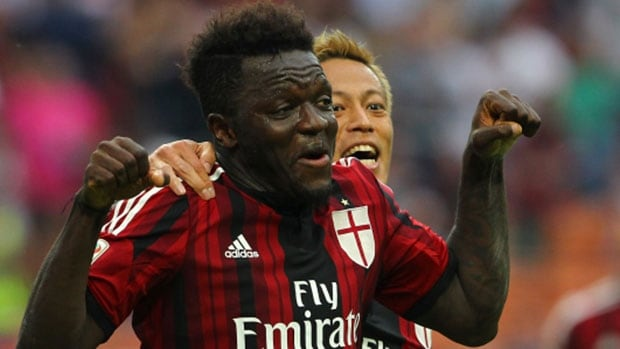 Sulley Ali Muntari of AC Milan, right, celebrates with his teammate Keisuke Honda after scoring his goal during the Serie A match between AC Milan and SS Lazio at Stadio Giuseppe Meazza in Milan, Italy.