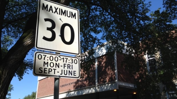 A new sign shows a lower speed limit around Grosvenor Elementary School in Winnipeg. The new limit took effect on Sept. 1.