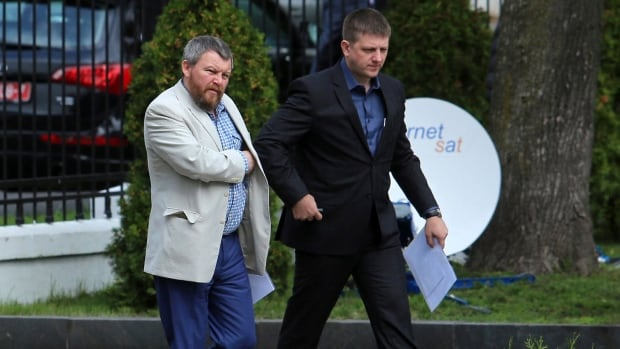 Pro-Russian rebel leaders from eastern Ukraine Andrei Purgin, left, and Alexey Karyakin  walk in Minsk, the Belarusian capital, to reach agreement on a ceasefire.  (AP Photo/Dmitry Brushko)