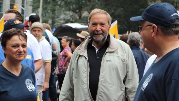 Federal NDP Leader Tom Mulcair greets participants at the annual Labour Day parade in Toronto.
