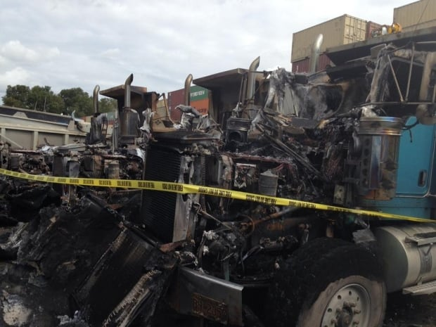 Three dump trucks destroyed in suspicious fire at Rusty's Towing in Richmond, B.C.
