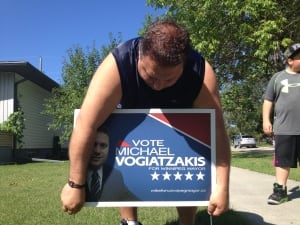 Mike Vogiatzakis with campaign sign