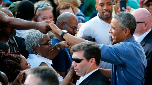U.S. President Barack Obama greets people in the crowd after delivering remarks at Laborfest 2014 at Maier Festival Park in Milwaukee, Wisconsin.