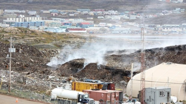 Smoke pours from Iqaluit's dump fire as the operation to put it out begins. Crews began dousing the fire on Sunday, August 31. The fire began May 20.