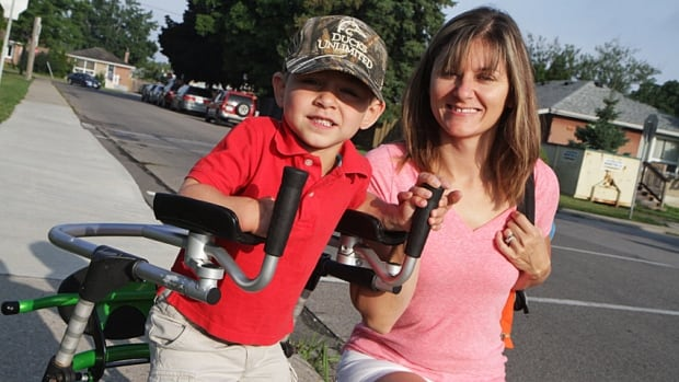 Denise Hierlihy takes her son Dylan in for his first day of school at Linden Park on the Mountain. Linden Park is set to close in June.