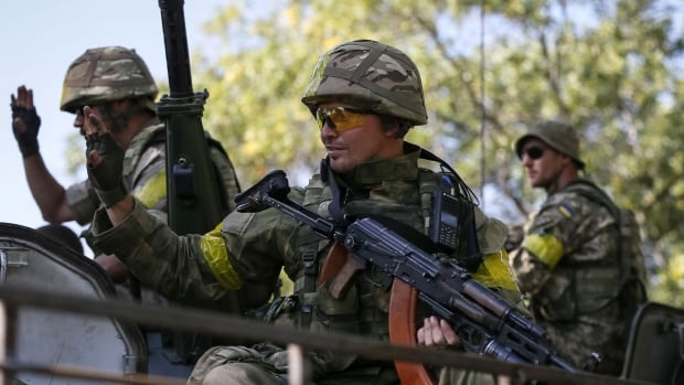 Ukrainian servicemen ride in an armoured vehicle near Kramatorsk. A multinational peacekeeping exercise in Ukraine that is held annually will begin Sept. 11.