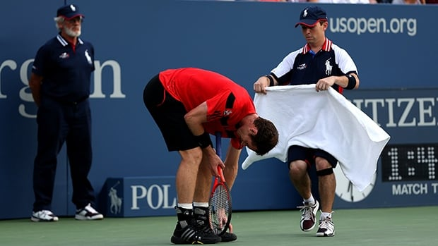 A ballboy brings Andy Murray a towel in the U.S. Open at the USTA Billie Jean National Tennis Center in Flushing Meadows, N.Y.