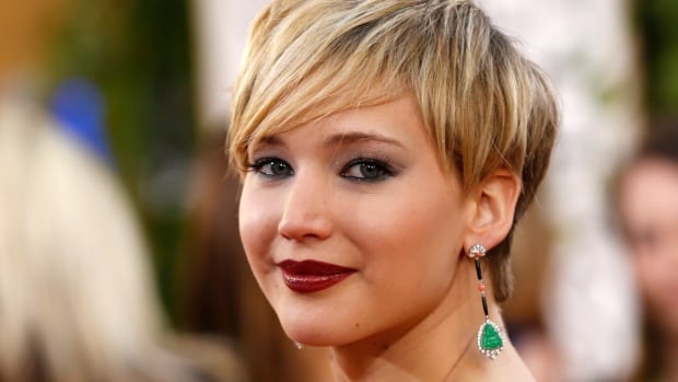Photos of Academy Award winner Jennifer Lawrence and others in various states of undress began appearing online Sunday. The FBI is investigating.