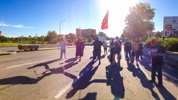 Protesters walked down Portage Avenue on Tuesday, calling for a national inquiry into missing and murdered women. Winnipeg police advised traffic delays near the Empress Underpass.