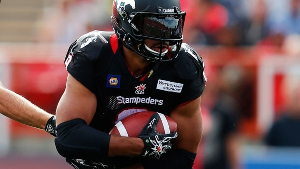Stampeders running back Jon Cornish rushed for a season-high 163 yards and added a touchdown Calgary's Labour Day victory over the Edmonton Eskimos.