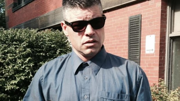 RCMP Cpl. Ron Francis entered Fredericton provincial court on Wednesday holding a single feather before he pleaded guilty to three charges. Three other charges were withdrawn.