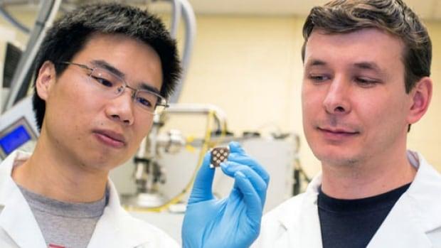 Professor Sargent's lab members, Zhijun Ning and Oleksandr Vozny, examining a new paint-on solar chip.