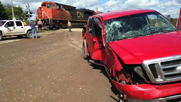The westbound CN Rail freight train slammed into the passenger side of the pickup truck in Salisbury on Wednesday.