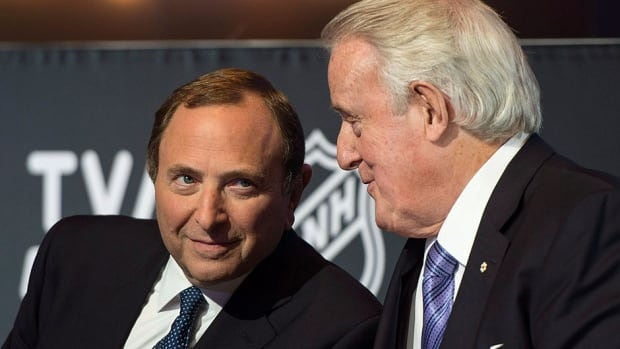 """NHL commissioner Gary Bettman, left, and Brian Mulroney, chairman of the board at Quebecor Inc., chat at the launch of the NHL season on TVA Sports network Wednesday in Boucherville, Que. Bettman called last week's report that the NHL would expand by four teams a """"complete fabrication."""""""