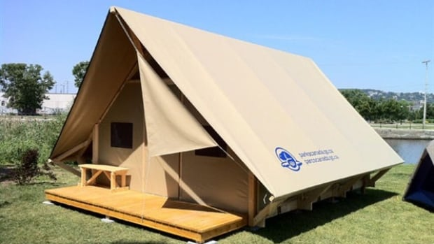 Parks Canada describes Otentiks as a cross between a tent and a rustic cabin. There is a canvas-like roof over a wooden A-frame that is built off the ground. Rain rolls off the roof.