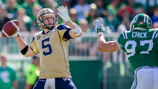 """Blue Bombers quarterback Drew Willy, left, had """"precautionary"""" X-rays on his ankle and appears ready to play in a Labour Day rematch against Saskatchewan on Sunday, says Winnipeg head coach Mike O'Shea."""
