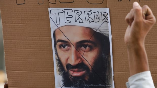 A member of the All India Anti-Terrorist Frontgestures in front of a portrait of al-Qaeda leader Osama bin Laden in the northern Indian state of Uttar Pradesh after he was killed in 2011, events around bin Laden's death, but Ayman al-Zawahri said Thursday the group was united and ready to fight enemies in the Indian subcontinent.