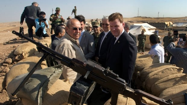 Foreign Affairs Minister John Baird, right, and Iraq's then deputy prime minister Rowsch Nuri Shaways toured a Kurdish bunker in Kalak, Iraq, last month, coming within eyeshot of ISIS's front lines.