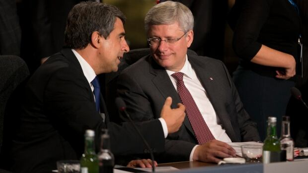 Prime Minister Stephen Harper, right, speaks with Bulgarian President Rosen Plevneliev before the start of a NATO-Afghanistan round table during the NATO summit in Newport, Wales Thursday.