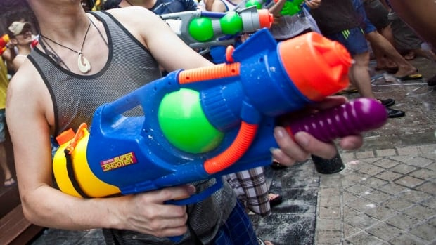 A woman and a young man were fined for spraying a woman with water pistols at a golf course in west Quebec on Wednesday.