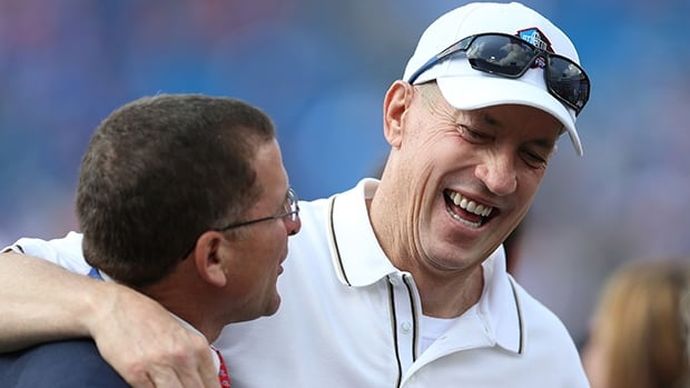 Jim Kelly, right, enjoys a chuckle on the sidelines prior to a Buffalo Bills pre-season game at Ralph Wilson Stadium on Aug. 23.