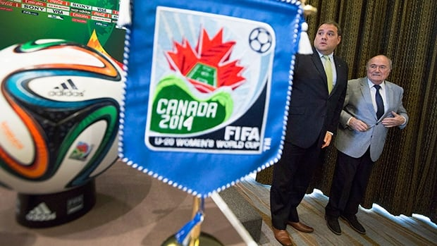 CSA president Victor Montagliani, left, defends the decision to stage the Women's World Cup in stadiums using artificial turf.