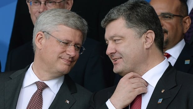 Prime Minister Stephen Harper, left, announced Ukrainian President Petro Poroshenko, right, will visit Canada next week.