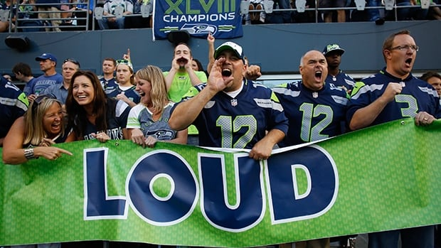 Fans cheer the Seattle Seahawks and the Green Bay Packers at CenturyLink Field in the NFL season opener on Thursday night.