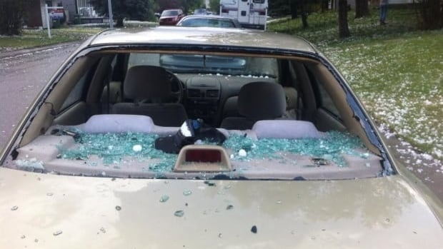 Golf ball-sized hail destroyed the windshield of this car in Airdrie.