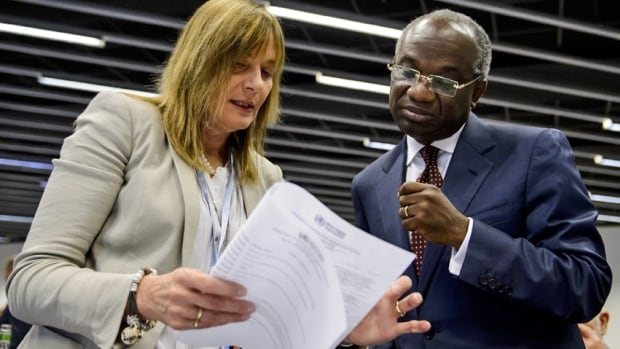 Marie-Paule Kieny, left, World Health Organization (WHO) French Assistant Director-General for Health Systems and Innovation, speaks with WHO Ghanaian deputy director-general Anarfi Asamoa-Baah prior to the opening of a two-day meeting on consultation on potential Ebola therapies and vaccines in Geneva.