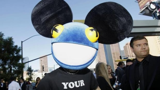 Deadmau5, seen here performing at the 2012 Grammy Awards in Los Angeles,  has reportedly settled a legal battle with Disney over his signature mouse head costume.
