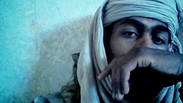 In a Facebook posting a year ago, Collin Gordon is seen wearing army fatigues and a scarf wrapped around his head. In the comments, he responded to a relative who referred to al-Qaeda, saying 'Al-Qaeda are Muslims and I stand by them in this life and the next as I do with any and every Muslim,'  while also denying he was affiliated with the militant group.