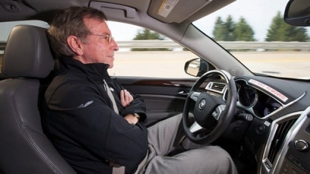 Jeremy Salinger, General Motors R&D manager for Super Cruise, demonstrates semi-automated driving that could be available on Cadillac models by 2017.