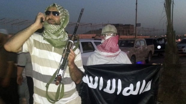 ISIS fighters with weapons and flag | ozara gossip