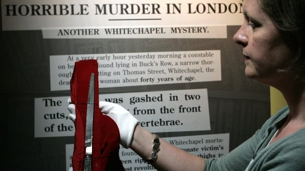 A member of the the Museum in Docklands holds a knife allegedly used by Jack the Ripper.  A new book claims Aaron Kosminski, a Polish immigrant, was responsible for the killings.