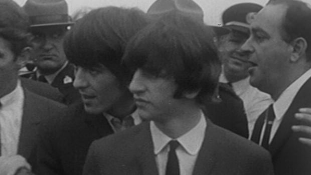 George and Ringo of the Beatles step off their airplane at the Montreal airport on Sept. 8, 1964 and are greeted by hordes of screaming girls.