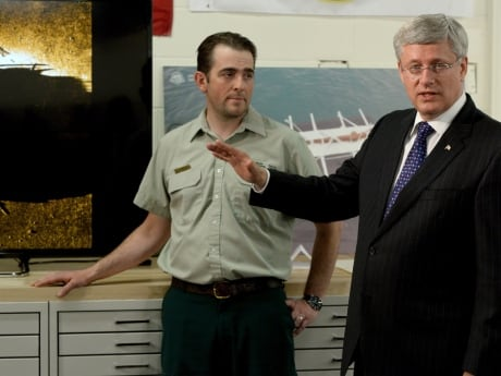Prime Minister Stephen Harper stands with Ryan Harris, senior underwater archeologist for Parks Canada, after announcing one of the ships from Sir John Franklin's doomed 1845-46 expedition has been found.